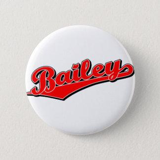 Bailey script logo in red button