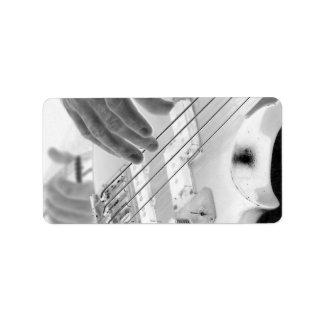 Bajista, bajo y mano, imagen negativa etiqueta de dirección