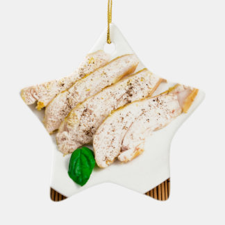 Baked chicken breast sliced on a white plate ceramic ornament