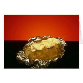 Baked potato with sour cream, against orange backg card