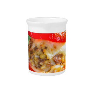 Baked stuffed peppers with meat sauce and cheese beverage pitcher