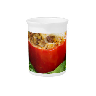 Baked stuffed peppers with meat sauce and cheese drink pitchers