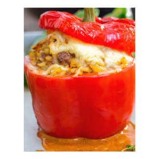 Baked stuffed peppers with meat sauce and cheese letterhead