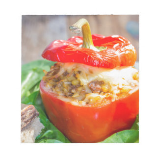 Baked stuffed peppers with meat sauce and cheese notepad