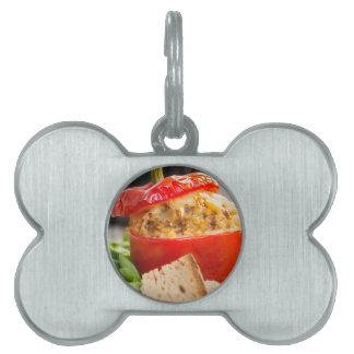 Baked stuffed peppers with meat sauce and cheese pet tag