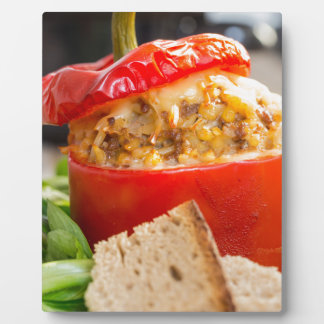 Baked stuffed peppers with meat sauce and cheese plaque