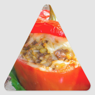 Baked stuffed peppers with meat sauce and cheese triangle sticker