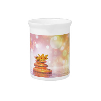 Balance pebbles with flowers beverage pitchers