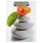 Balanced stones and red flower clipboard