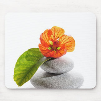 Balanced stones and red flower mousepads