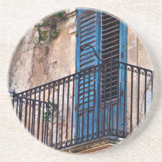 Balcón azul en Sicilia Apoyavasos