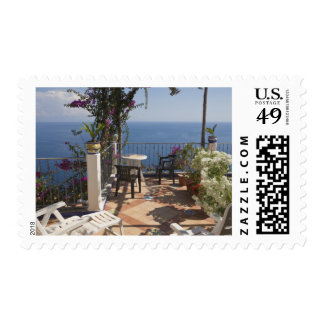 Balcony with sunloungers overlooking sea, postage stamp