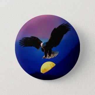 Bald eagle descends onto the moon button