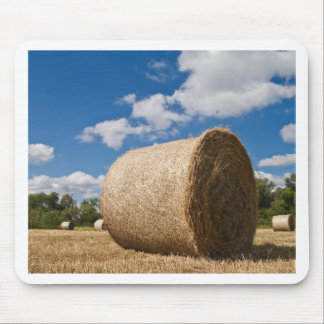 Bale of straw with clouds and blue sky mouse pad