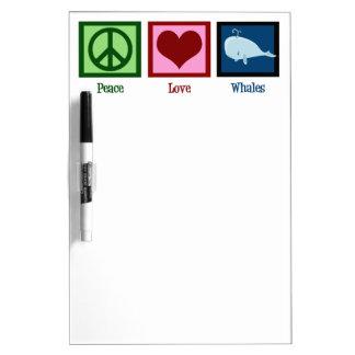 Ballenas del amor de la paz tablero blanco