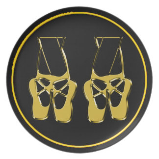 Ballet toe shoes on black background plate