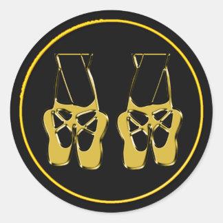 Ballet toe shoes on black background sticker