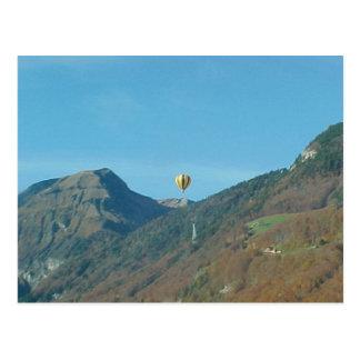 Balloon over the mountains postcard