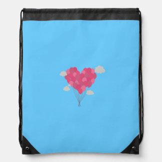Balloons arranged as heart drawstring backpack