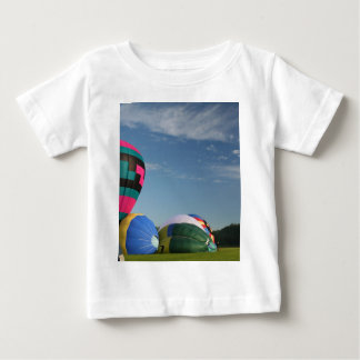 Balloons inflating at xlta event baby T-Shirt