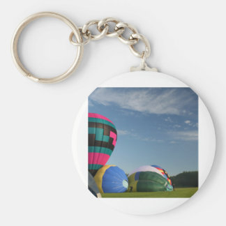 Balloons inflating at xlta event basic round button keychain