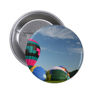 Balloons inflating at xlta event pinback button