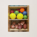 Balls stored in cabinet jigsaw puzzles