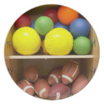 Balls stored in cabinet plates