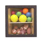 Balls stored in cabinet premium keepsake boxes