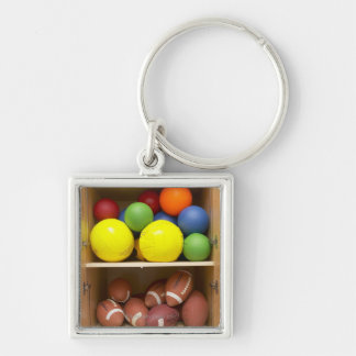 Balls stored in cabinet Silver-Colored square keychain