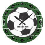 Balón de fútbol adaptable en campo reloj de pared
