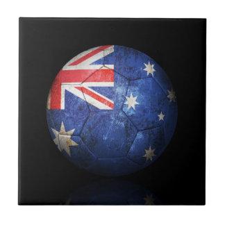 Balón de fútbol australiano gastado de fútbol de b azulejo ceramica