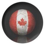 Balón de fútbol canadiense gastado de fútbol de ba platos