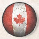 Balón de fútbol canadiense gastado de fútbol de ba posavaso para bebida