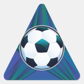 Balón de fútbol en fondo de los rayos pegatina triangular