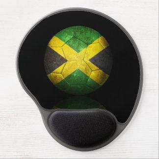 Balón de fútbol jamaicano gastado de fútbol de ban alfombrilla con gel