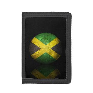 Balón de fútbol jamaicano gastado de fútbol de ban