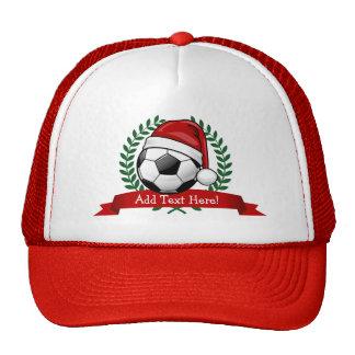 Balón de fútbol navidad de un gorra de Santa que