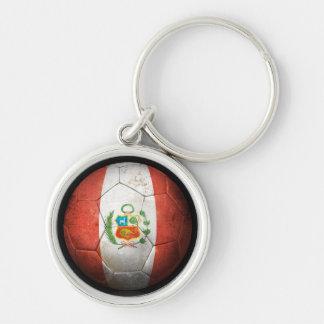 Balón de fútbol peruano gastado de fútbol de bande llavero redondo plateado