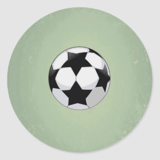 Balón de fútbol y fondo verde del vintage pegatina redonda