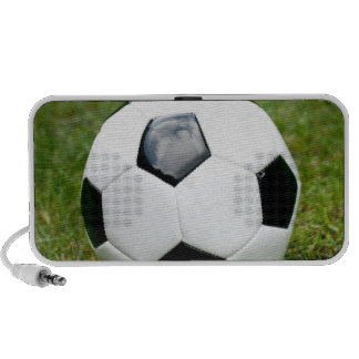 Balón de fútbol y fotografía de la hierba altavoces