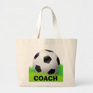 Balón de fútbol y la bolsa de asas del diseño del