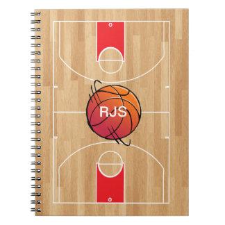 Baloncesto del monograma en la cancha de básquet cuaderno