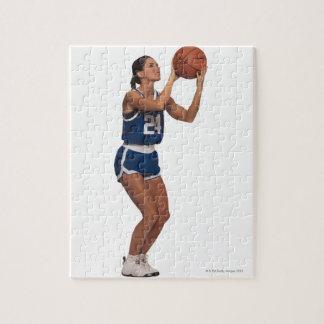 Baloncesto del tiroteo del jugador de la mujer puzzle con fotos