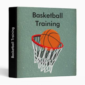 Baloncesto y carpeta del entrenamiento del aro