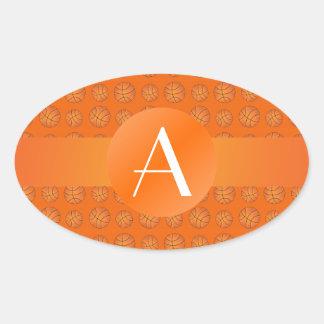 Baloncestos del naranja del monograma colcomanias óval