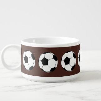 Balones de fútbol blancos y negros de los tazón