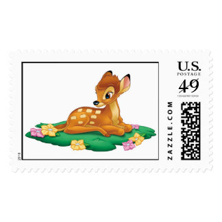 Bambi sitting on the grass postage stamps