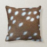 Bambi white spots on a brown fur pillows