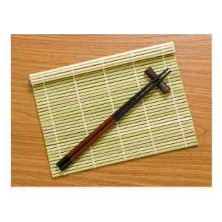 Bamboo mat with chopsticks postcard